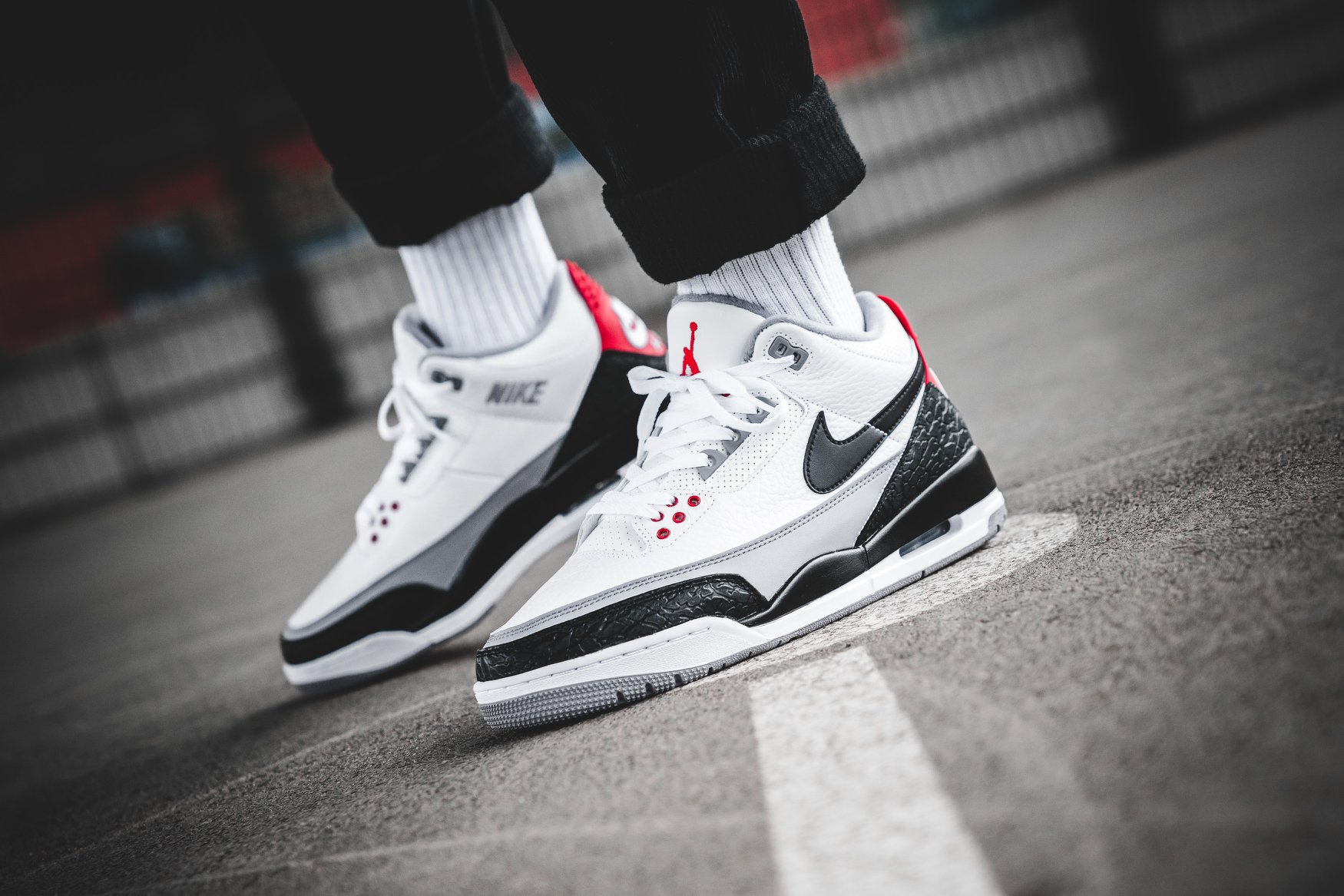 5d7aae2b24 The fire red colourway is complemented by White, Cement Grey and Black with  classic translucent Air bubble and further Air Jordan graphics and Tinker`s  ...