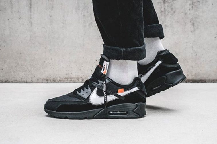 official photos e1361 6e61f ... Nike Air Max 90. This time the classic silhouette comes dressed in a   Black  colorway with orange hits. The deconstructed design as we know is  kept ...
